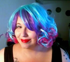 Brandy rocking a colorful wig.