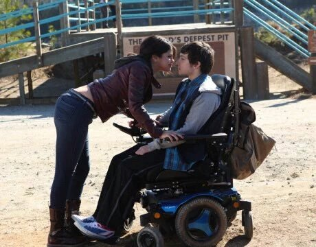 Dot and Trevor kiss in The Fundamentals of Caring.