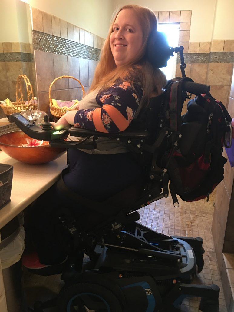 Partially standing at my sink in the Permobil F5 VS power wheelchair.