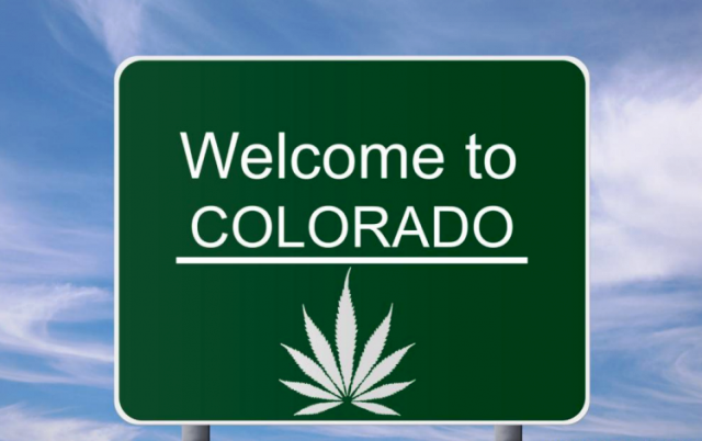 Welcome to Colorado sign with cannabis leaf.