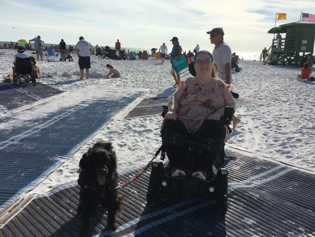Karin and Aria enjoying the mobi-mat wheelchair accessible path on Siesta Key Beach near Sarasota, Florida.