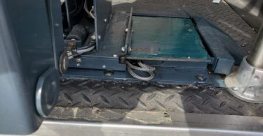 Defective VMI Ricon Slide-Away Wheelchair Lift with wires sticking out in need of repair.