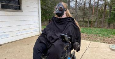 Karin wearing a plague doctor mask.